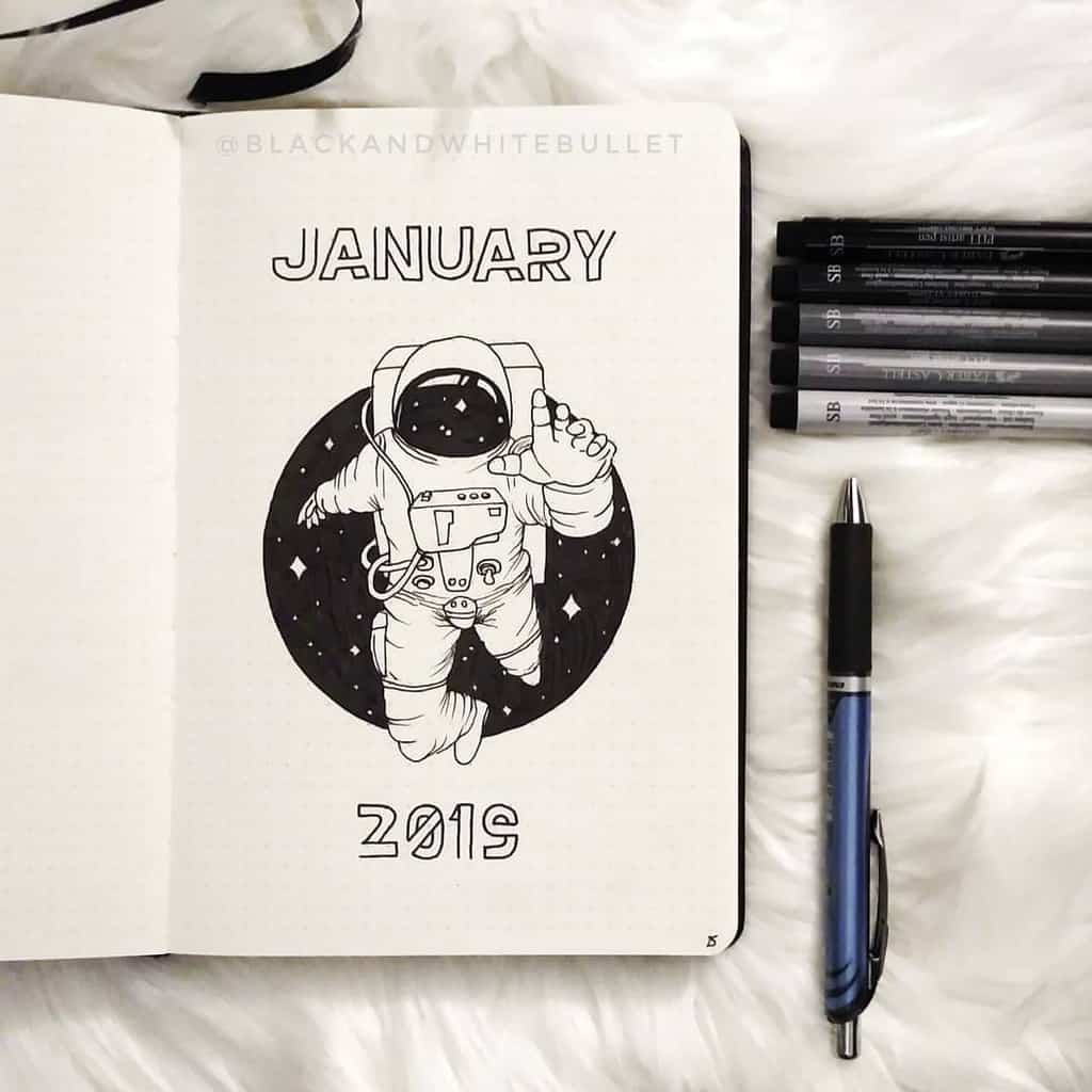 Space and Galaxy Bullet Journal Theme Inspirations - cover page by @blackandwhitebullet | Masha Plans