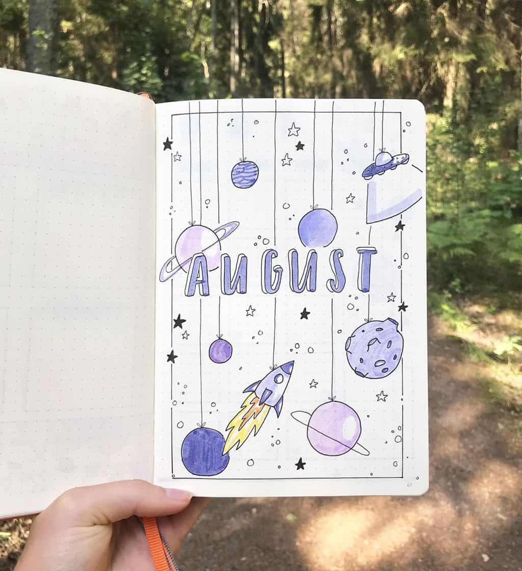 Space and Galaxy Bullet Journal Theme Inspirations - cover page by @bulletwithe | Masha Plans