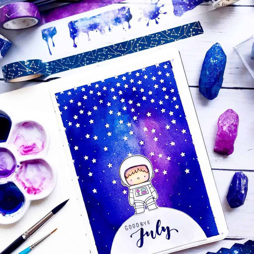 Space and Galaxy Bullet Journal Theme Inspirations - cover page by @xpaperwingsx | Masha Plans