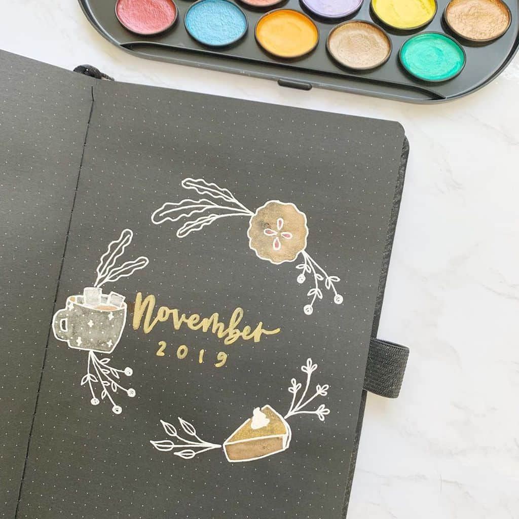 Fall Bullet Journal Theme Inspirations - cover page by @erinflotodesigns | Masha Plans